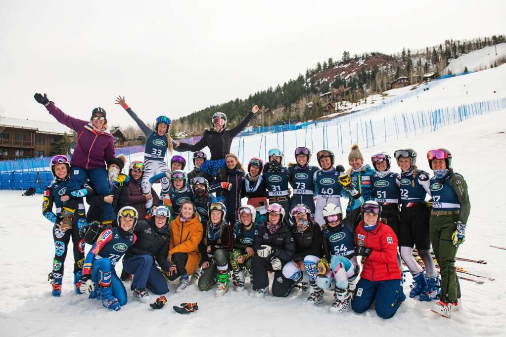 Women alpine skiers pose for a large group photo after the Super G National Championships at Aspen Highlands on Tuesday, April 13, 2021. (Kelsey Brunner/The Aspen Times)