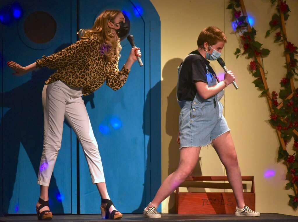 """Seniors Emma Lane, left, and Tobi Elerick perform """"Dancing Queen"""" as Tanya and Rosie in Middle Park's production of """"Mamma Mia!"""""""