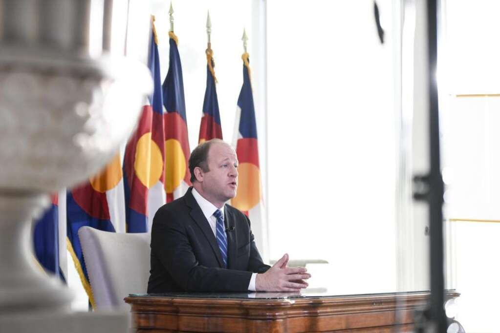 Colorado Governor Jared Polis delivers an address from the governor's mansion on Monday, April 6, 2020. | Courtesy The Denver Post/Getty Images