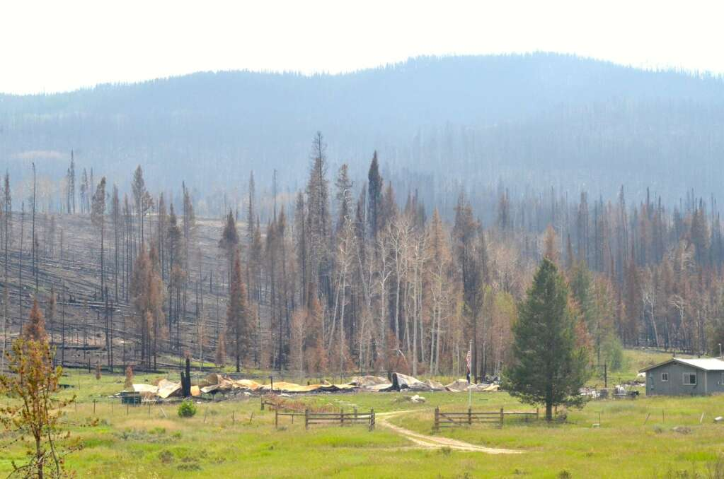 The remnants of trailers and an outbuilding at Lynx Pass Ranch. The structures were burned in the early hours of June 22, when the fire saw significant growth. (Photo by Dylan Anderson)