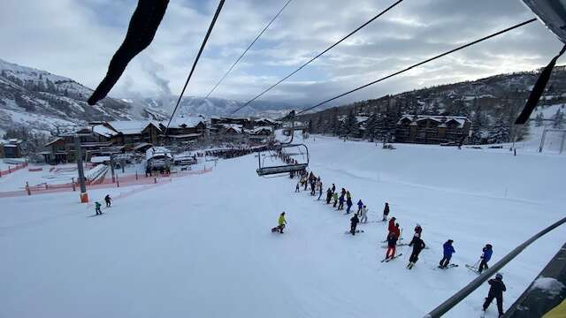 By the time the Village Express lift opened Thursday morning, the first-chair line stretched up Fanny Hill. The report of 20 inches at Snowmass from the overnight snowstorm brought out the crowds.  (David Krause / The Aspen Times)