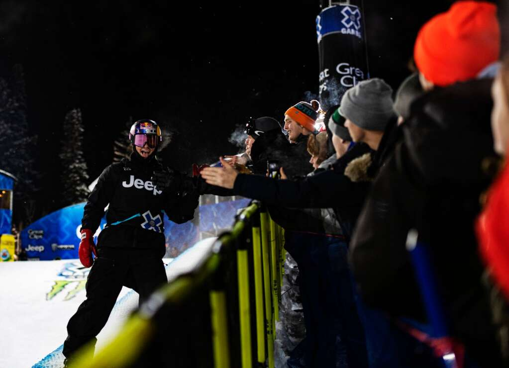 X Games Men's Snowboard Superpipe returning gold medalist, Scotty James, claps hands with the crowd on the side of the feature during his last run on Thursday, Jan. 23, 2020. The X Games win gave him his tenth gold medal in a row. (Kelsey Brunner/The Aspen Times)