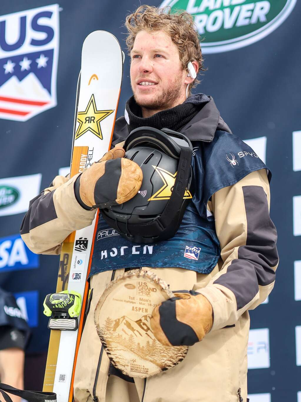 Crested Butte's Aaron Blunck listens to the national anthem on the podium after his win in the men's freeski halfpipe final at the U.S. Grand Prix and World Cup on Sunday, March 21, 2021, at Buttermilk Ski Area in Aspen. Photo by Austin Colbert/The Aspen Times.
