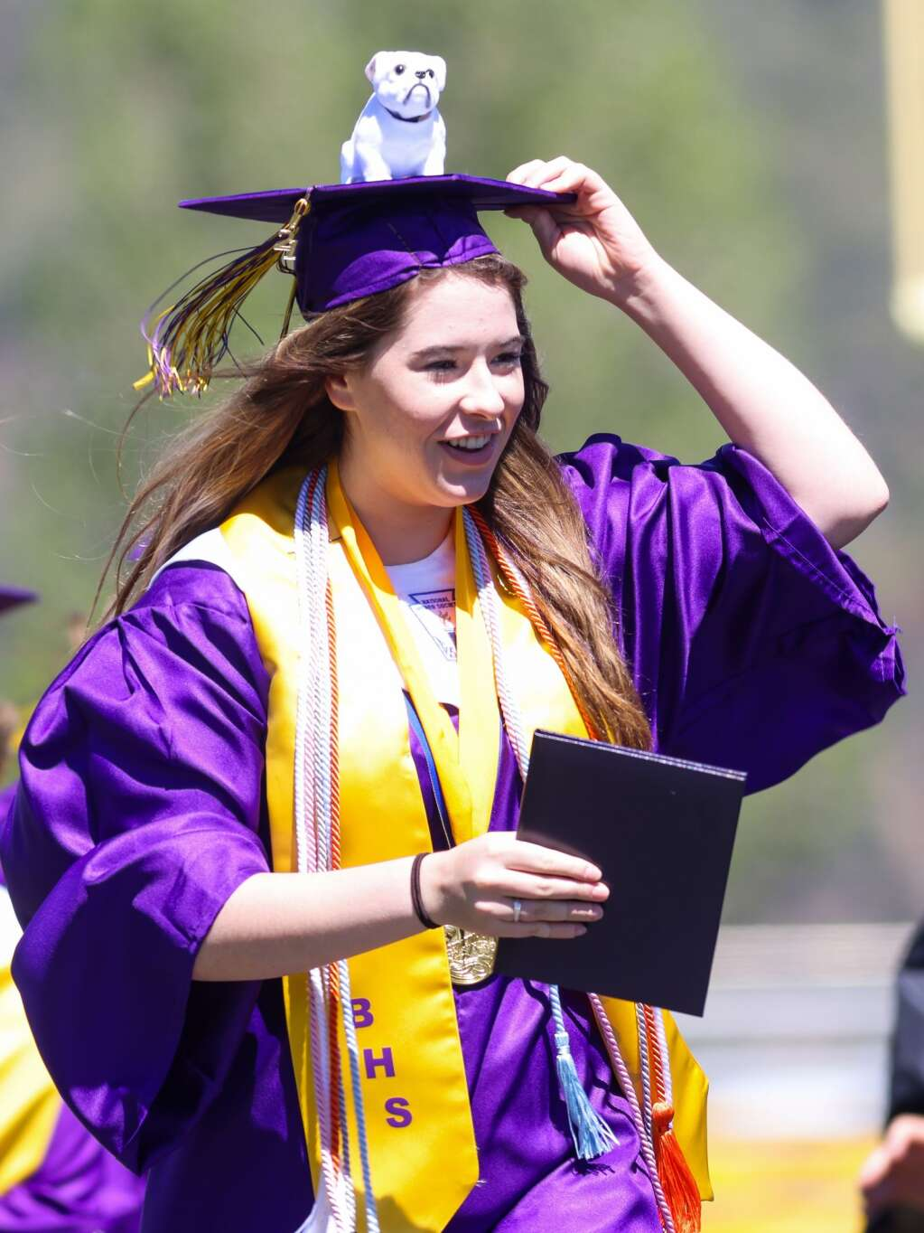 Valedictorian Mari Elliott receives her diploma during the Basalt High School graduation ceremony on Saturday, May 22, 2021, on the BHS football field. Photo by Austin Colbert/The Aspen Times.