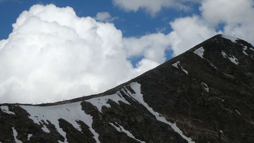 Hikers ascend and descend Torreys Peak as storm clouds build on a weekday in August 2019. The view is from Grays Peak.   CFI-Lloyd Athearn/courtesy photo
