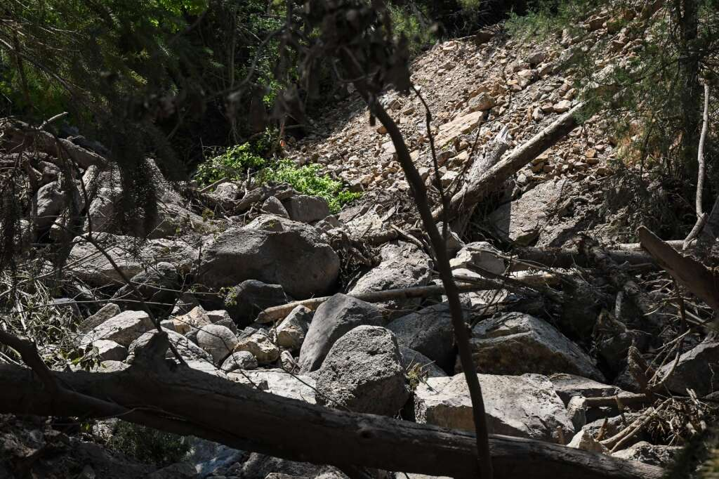 Damage left behind from a mud and debris slide that flooded Cinnamon Creek above the Hanging Lake Tunnels on Thursday, July 22. |Chelsea Self / Post Independent