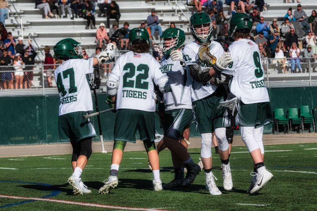 The Summit High School varsity boys lacrosse team celebrates a goal during the Tigers' 10-4 senior night loss to Aspen at Tiger Stadium in Breckenridge on Thursday. | Photo by Joel Wexler / Rocky Mountain.Photography