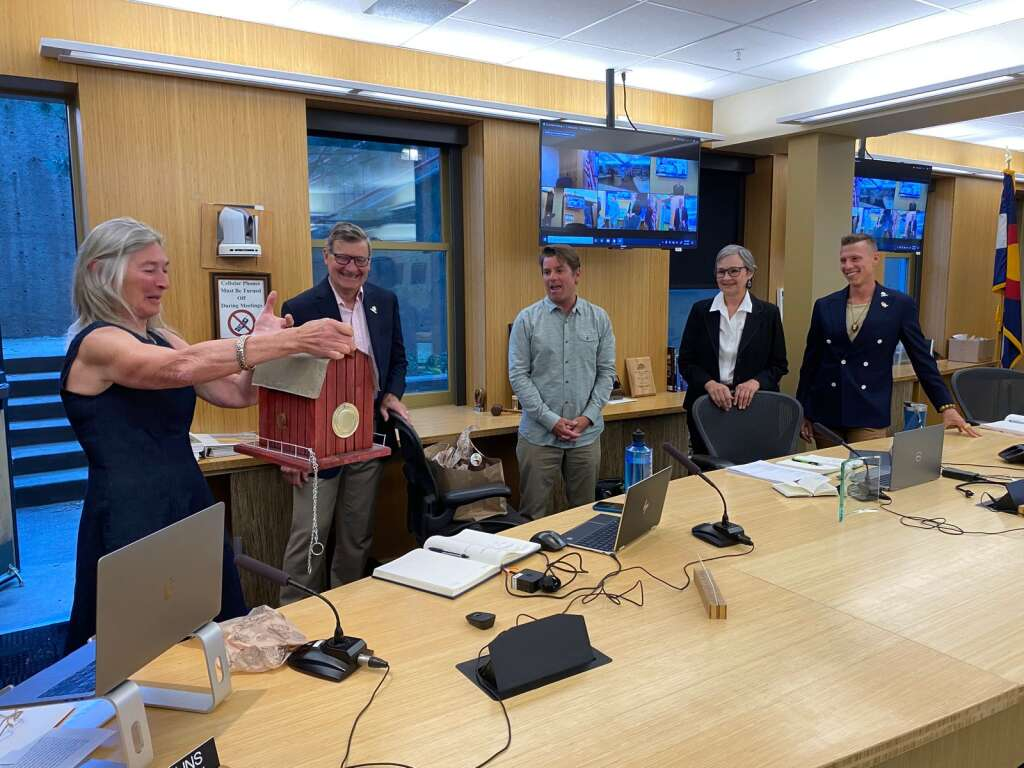 Former Aspen City Council member Ann Mullins receives a gift from council on her last day in office on Tuesday. | Carolyn Sackariason / The Aspen Times