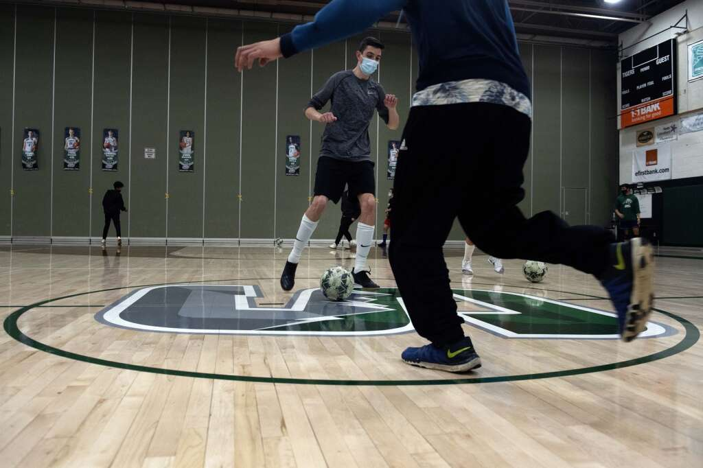 Summit High School boys varsity soccer players scrimmage against one another during an indoor practice at Summit High on Tuesday, March 16. | Photo by Jason Connolly / Jason Connolly Photography