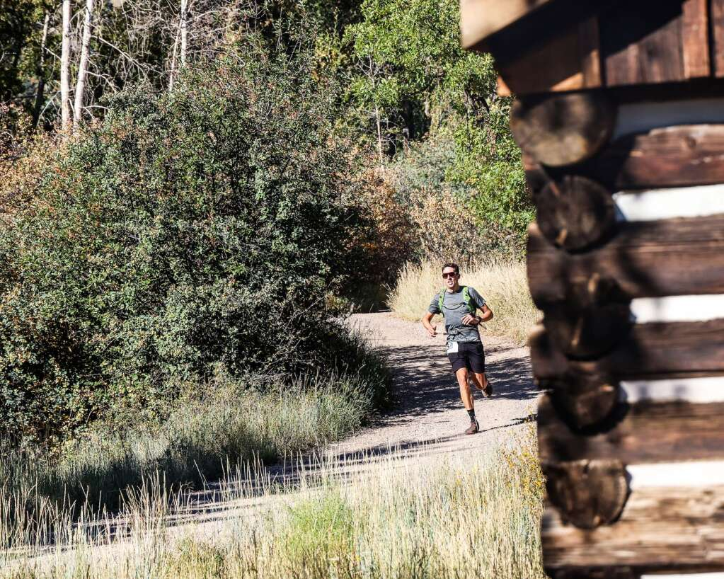 Niwot's Isaiah Newkirk passes by the Holden/Marolt Mining & Ranching Museum during the Golden Leaf half marathon on Saturday, Sept. 18, 2021, in Aspen. Photo by Austin Colbert/The Aspen Times.