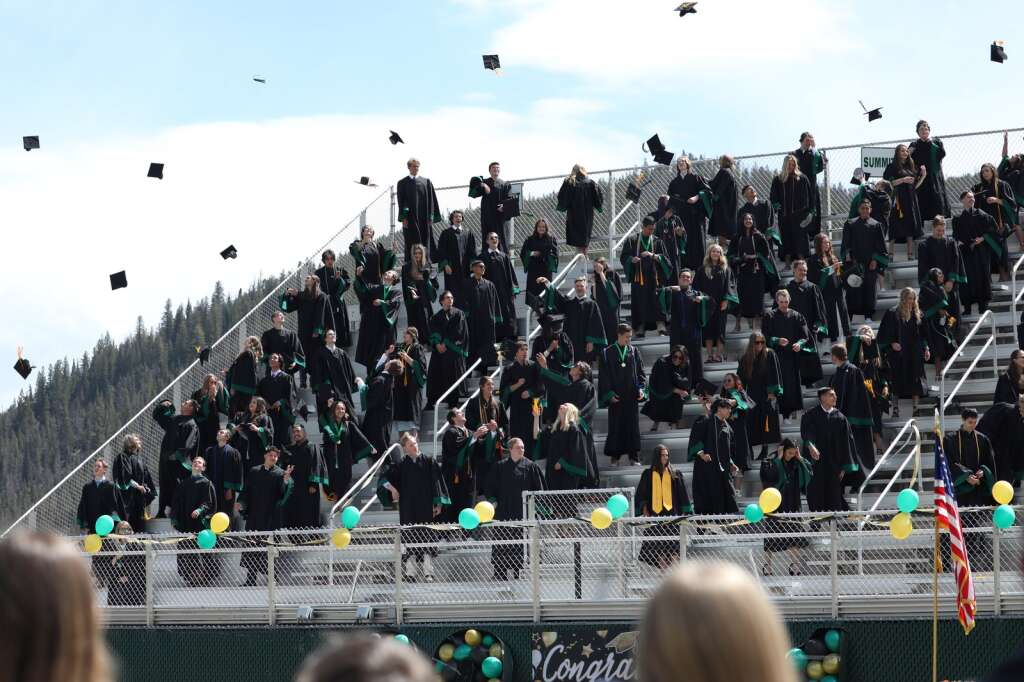 Students from the Summit High School class of 2021 toss their graduation caps in the air during a ceremony Saturday, May 29, in Breckenridge.   Photo by Ashley Low