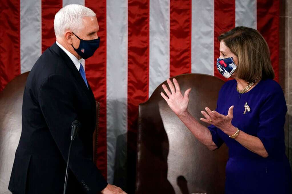 Speaker of the House Nancy Pelosi, D-Calif., and Vice President Mike Pence talk before a joint session of the House and Senate convenes to count the Electoral College votes cast in November's election, at the Capitol in Washington, Wednesday, Jan. 6, 2021. (AP Photo/J. Scott Applewhite)