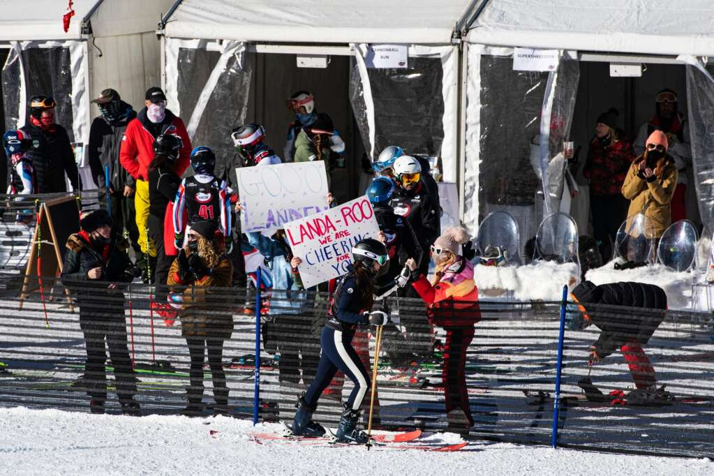 Local Landen Saks skis down to a cheering section at the base of the Stapleton Training Center at Aspen Highlands during the 2020 Ajax Cup on Wednesday, Dec. 30, 2020. (Kelsey Brunner/The Aspen Times)