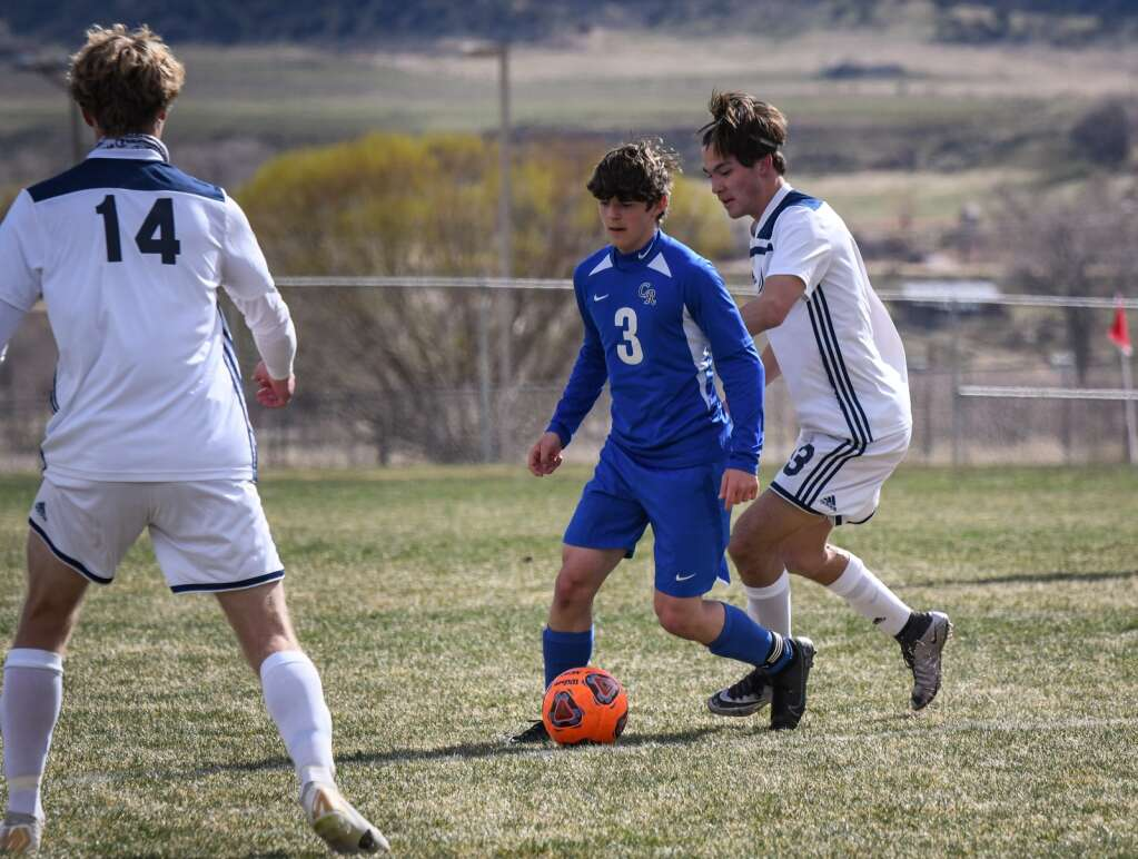 Coal Ridge Titan Ethan Stickler looks for an open teammate during Tuesday afternoon's game against the Vail Mountain Gore Rangers at Coal Ridge High School. |Chelsea Self / Post Independent
