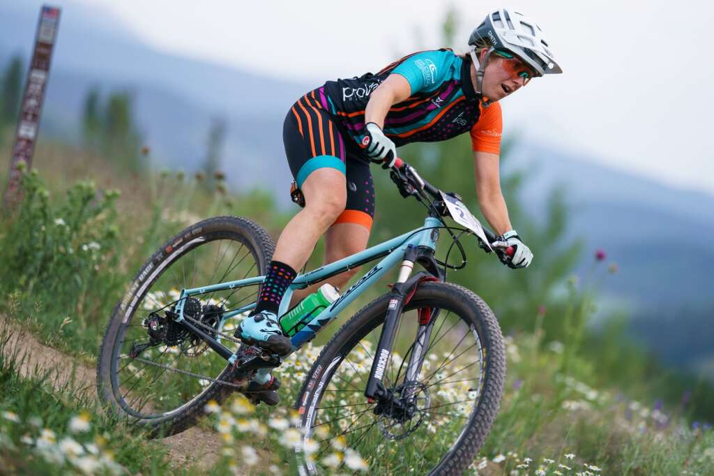 Women's expert division racer Sarah Carney rides downhill as she races to a second place finish at Wednesday's Soda Creek Scramble mountain bike race in Keystone.   Photo by John Hanson