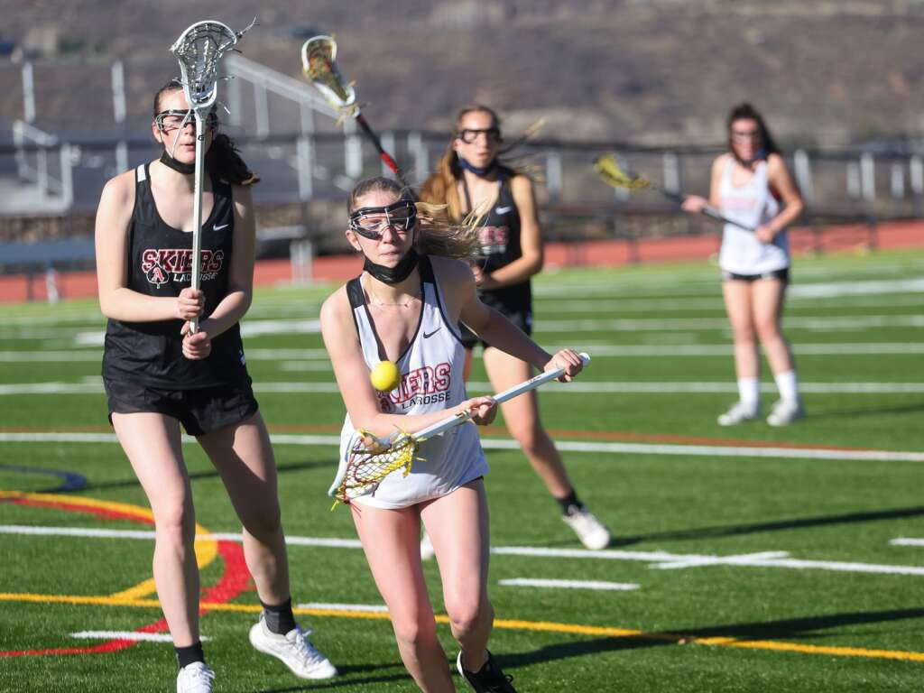 The Aspen High School girls lacrosse team practices on Friday, April 30, 2021, on the AHS turf. Photo by Austin Colbert/The Aspen Times.