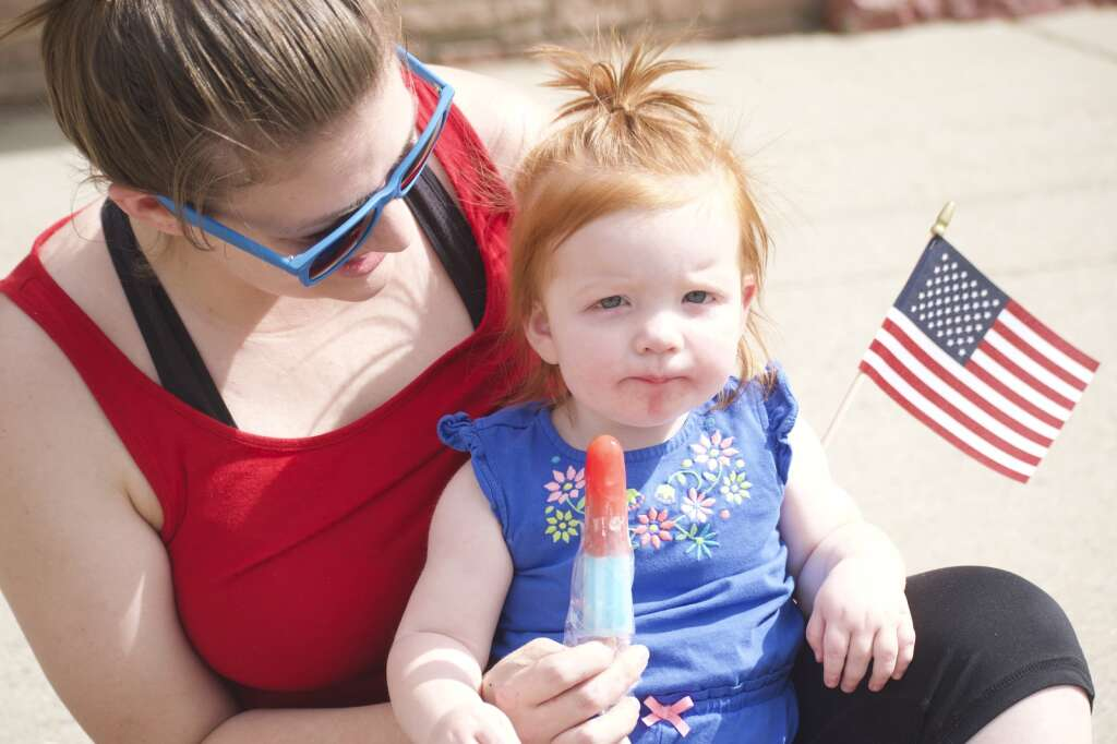 Mila Holbrook, with mom Chandrea, pose for a photo during Craig's Fourth of July parade, held July 5, 2021, marched down Victory Way Monday morning. | Cuyler Meade / Craig Press