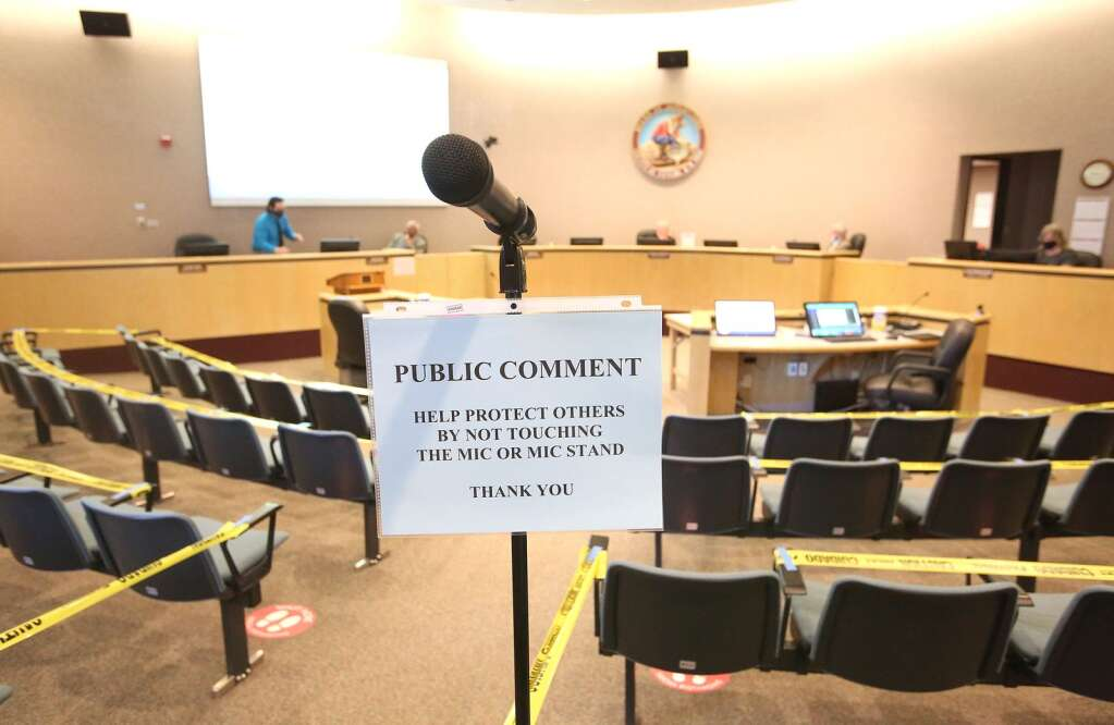 A single microphone placed at the back of the room, sits among a nearly empty Nevada County Board of Supervisors meeting June 23, the first publicly held meeting since March. Seating was limited to a fraction of the usually available seats to aid in social distancing. | Photo: Elias Funez