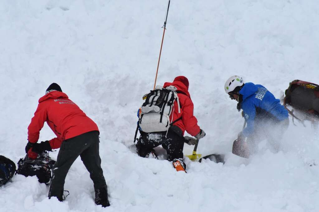 Rescuers use probes and shovels to try to dig out a dummy under the snow. | Photo by Sawyer D'Argonne / sdargonne@summitdaily.com