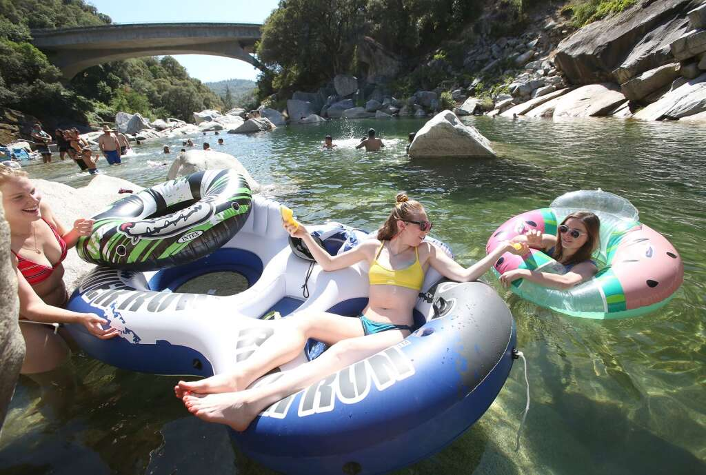 San Francisco's Kristen Struckmeyer (from left), Allie Epstein and Mac Malone enjoyed a relaxing day on the South Yuba River at the Highway 49 bridge July1.   Photo: Elias Funez