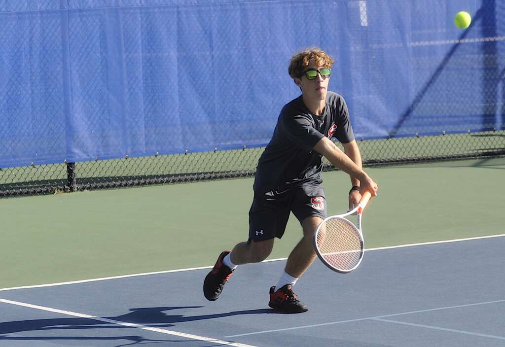 Steamboat Springs boys tennis player Xander Dalke watches the ball during a home competition against Rocky Mountain High School on Saturday morning. | Shelby Reardon/Steamboat Pilot & Today