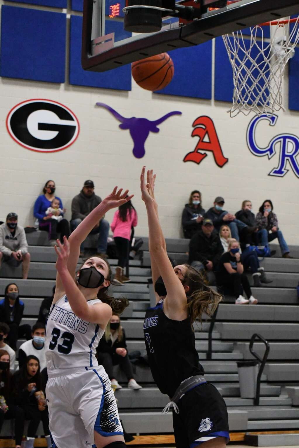 Coal Ridge Titan Taylor Wiescamp shoots for two points during Tuesday night's game against the Moffat County Bulldogs. | Chelsea Self / Post Independent