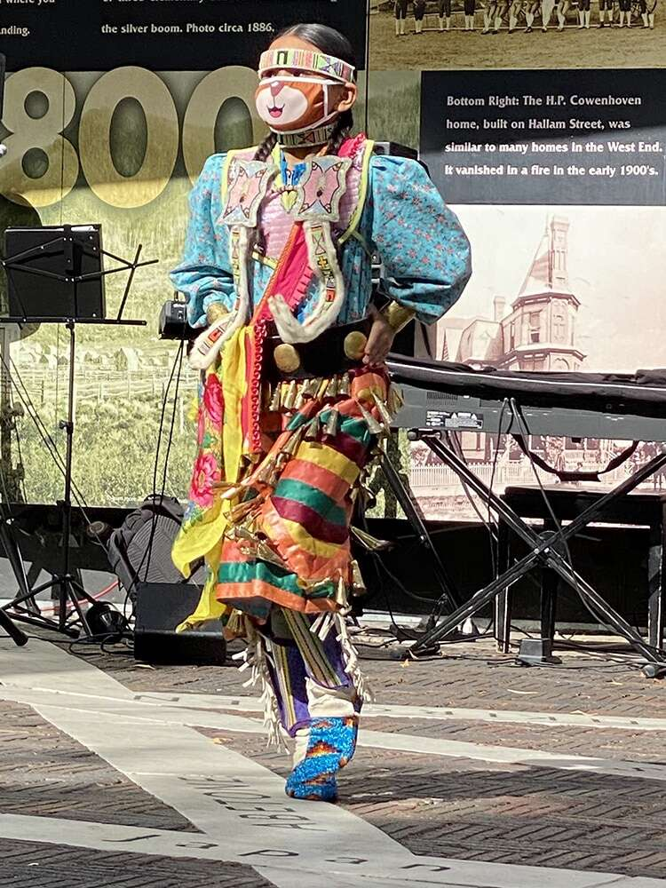 One of the younger performers dances in the Aspen Indigenous Foundation's presentation on the Aspen Sister Cities Plaza in October. | Aspen Times file photo