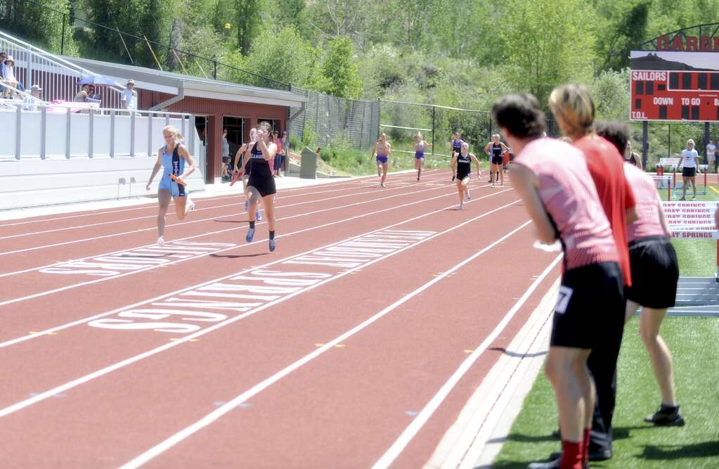 Teammates cheer on Steamboat senior Aliyah Reimer in the 4x100 relay during a home track and field meet at Gardner Field on Saturday afternoon. (Shelby Reardon)