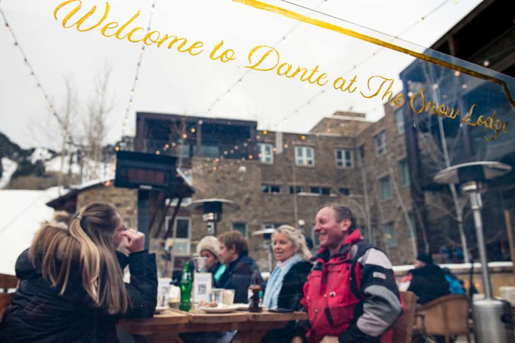 People enjoy apres on the patio at Dante at The Snow Lodge at the base of Aspen Mountain on Friday, Jan. 22, 2021. (Kelsey Brunner/The Aspen Times)
