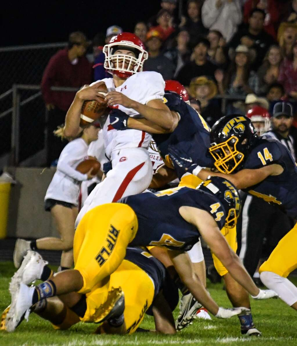 Glenwood Springs Demon Joaquin Sandoval is sacked by the defending Rifle Bears during Friday night's rivalry game.  Chelsea Self / Post Independent