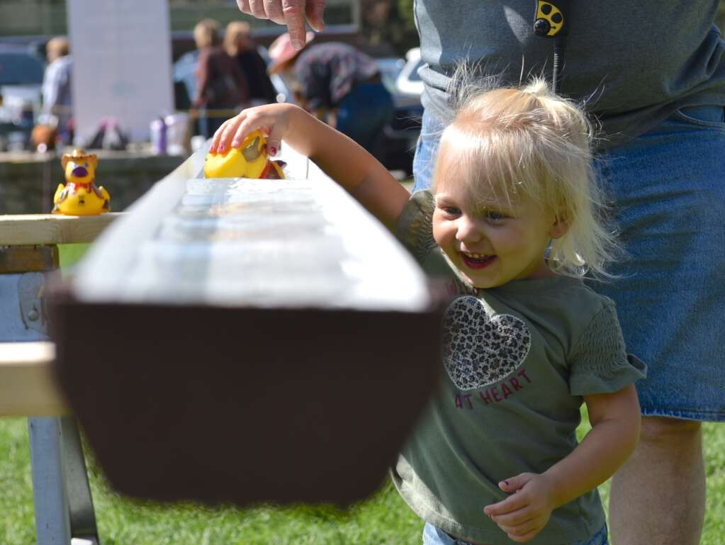 Duck races are another game enjoyed Saturday in Grand Lake.   Amy Golden / agolden@skyhinews.com