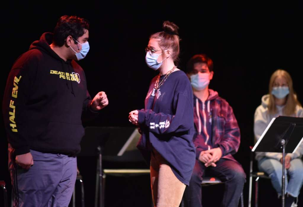 """Senior Cesar Arreguin as Jean Valjean rehearses a scene with senior Madeline Ruttenberg as Eponine. The high school's performance of """"Les Miserables"""" is being done in a concert format to comply with COVID-19 guidelines. 