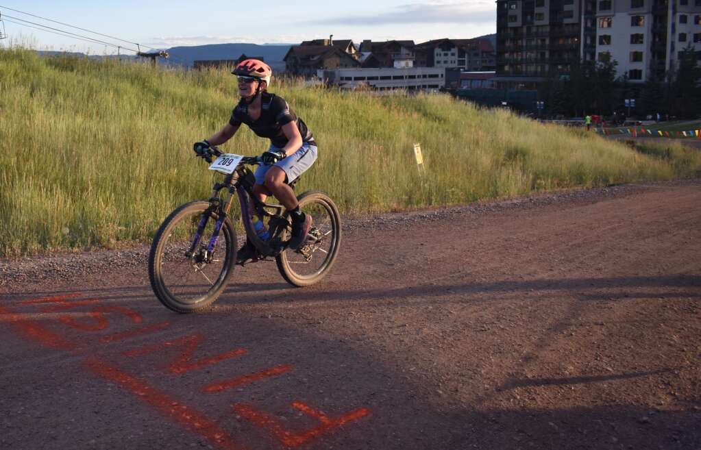 Sarah Glassmeyer crosses the finish line of the Mt. Werner Sunshine Loop, part of the Town Challenge in 2019.