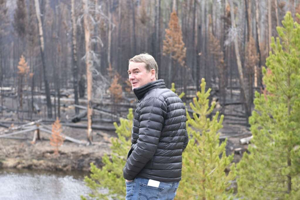 While standing at the border of Rocky Mountain National Park, which sports the burn scar from the East Troublesome Fire, and the Mueller Ranch, Bennet wished his Senate colleagues could be there to see the effects of land management. | McKenna Harford/mharford@skyhinews.com