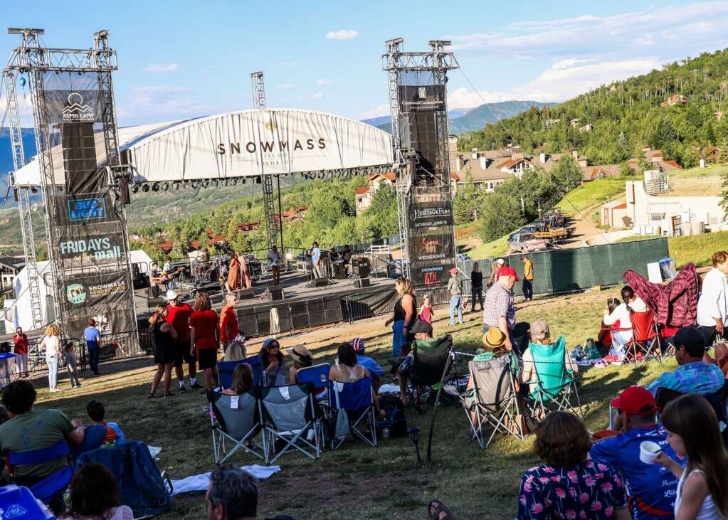 People dance and listen as Miss Mojo, a funk band from New Orleans, performs a free concert on Sunday, July 4, 2021, on Fanny Hill in Snowmass Village.   Austin Colbert/The Snowmass Sun