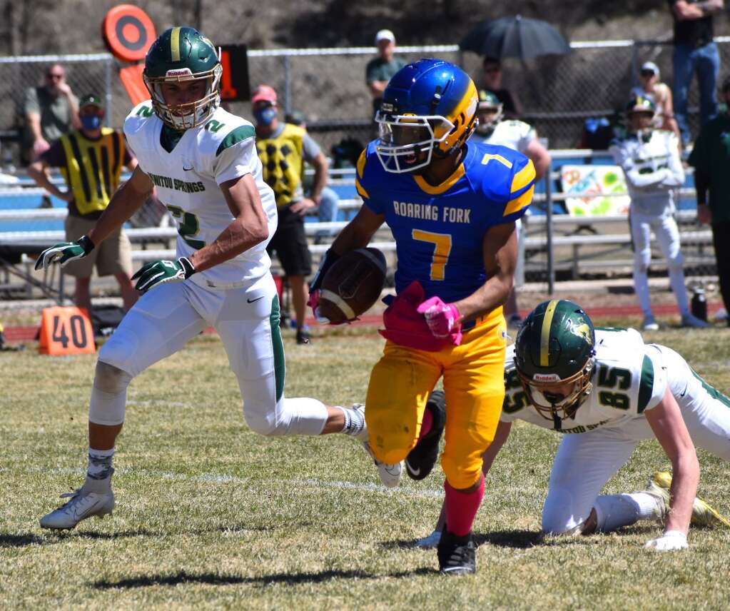 Roaring Fork sophomore Oscar Barraza rushes for some big yardage in the first half of the Rams' 47-6 loss to Manitou Springs on Saturday afternoon in Carbondale.