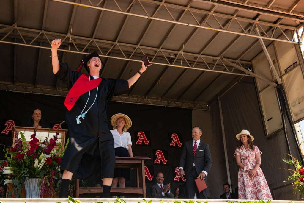 An Aspen High School graduate cheers as his name is called during the commencement ceremony on the football field in Aspen on Saturday, June 5, 2021. (Kelsey Brunner/The Aspen Times)