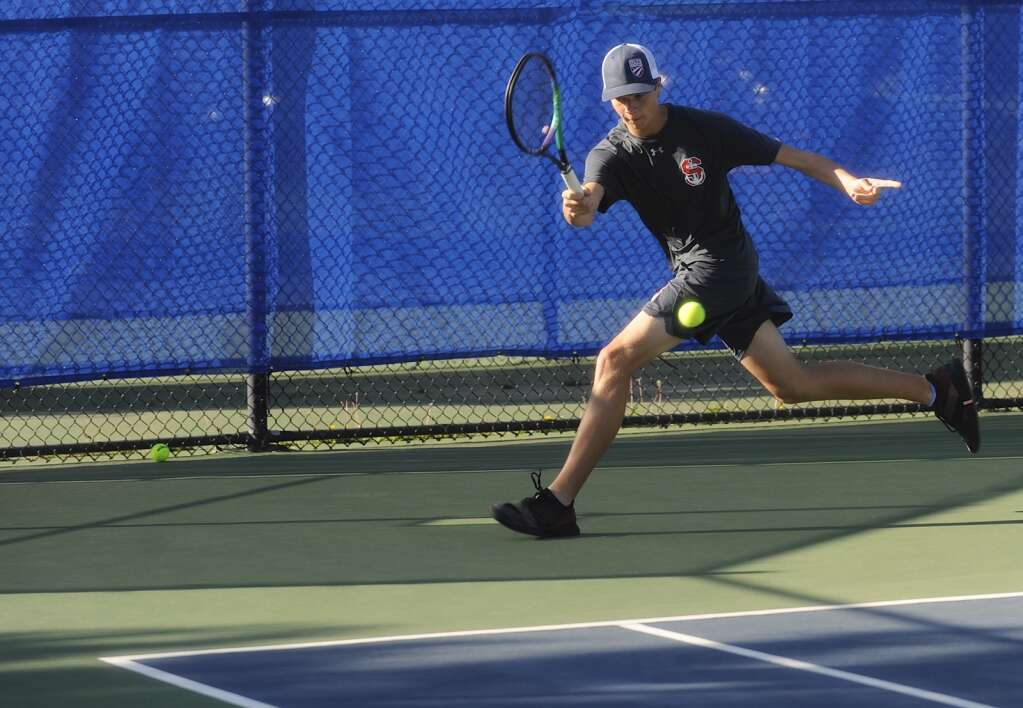Steamboat Springs boys tennis senior Nash Whittington competes in the No. 1 singles match during a home competition against Rocky Mountain High School on Saturday morning. | Shelby Reardon/Steamboat Pilot & Today