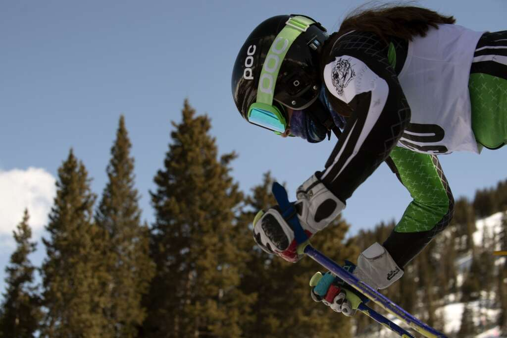 Summit High School Alpine ski team racer Sophia Henry pushes out of the starting gate during the girls giant slalom race during the Colorado High School State Alpine Ski Championships at Loveland Ski Area on Friday, March 12, 2021.   Photo by Jason Connolly / Jason Connolly Photography