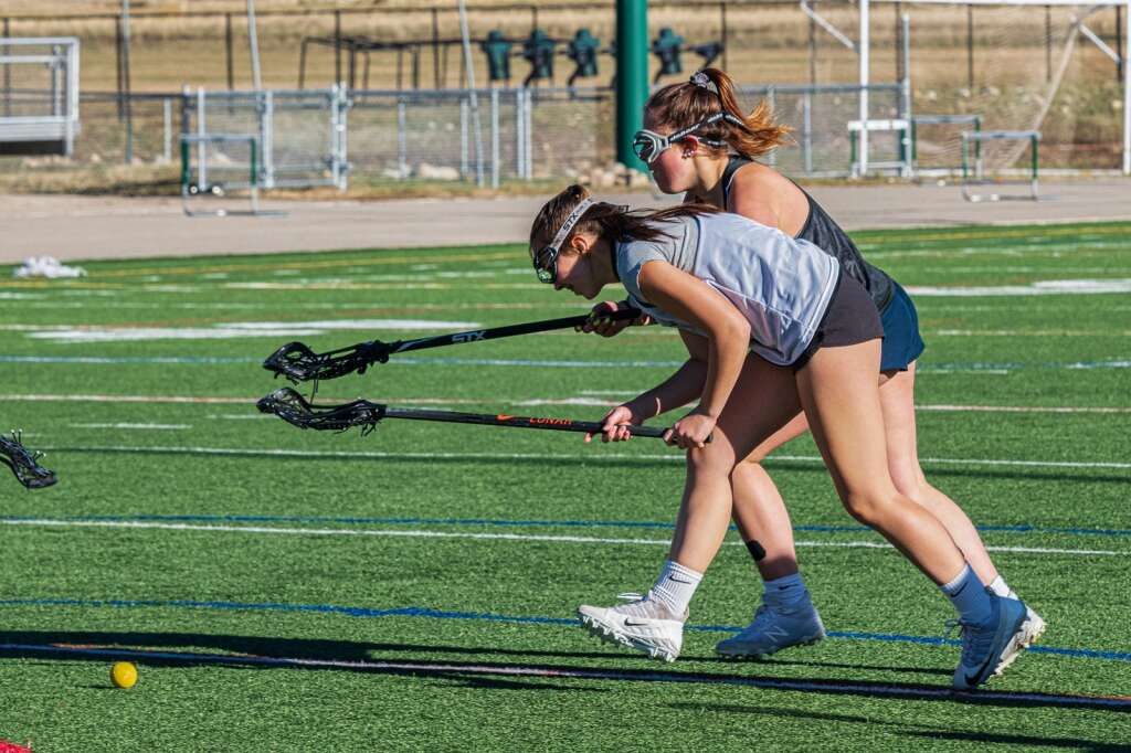 Lindsay Davis and Chloe Nicholds fight for a loose ground ball at Summit High School varsity girls lacrosse practice at Tiger Stadium in Breckenridge on Thursday, May 7, 2021. | Photo by Joel Wexler / Rocky Mountain.Photography