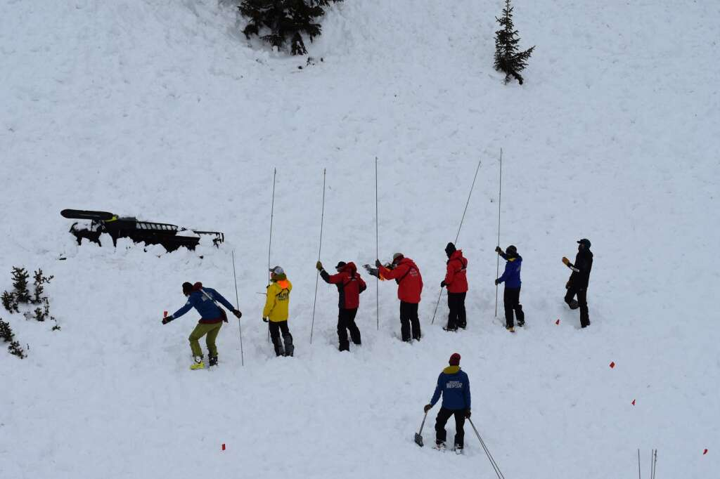 Rescue workers form a probe line to search for a missing snowmobiler during a mock avalanche rescue. | Photo by Sawyer D'Argonne / sdargonne@summitdaily.com