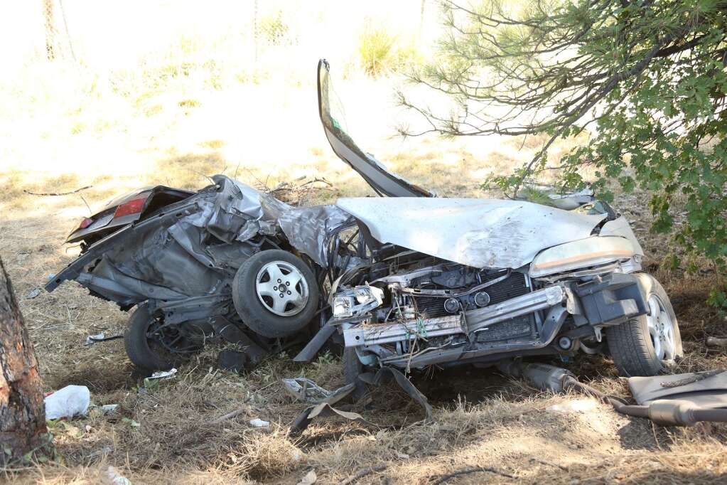 A vehicle sits on the side of Highway 49, severed in half after a vehicle collision Aug. 4. The driver survived this wreck. | Photo: Elias Funez
