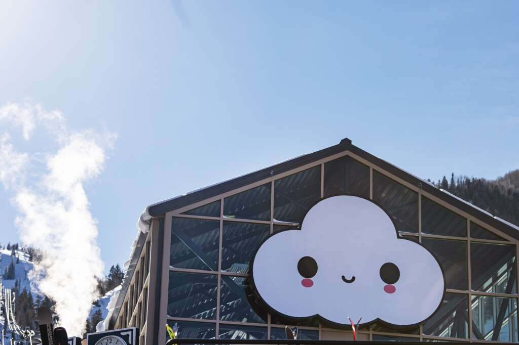 A FriendsWithYou Little Cloud installation hangs on the front of the Silver Queen Gondola building at Aspen Mountain on Wednesday, Jan. 6, 2021. (Kelsey Brunner/The Aspen Times)