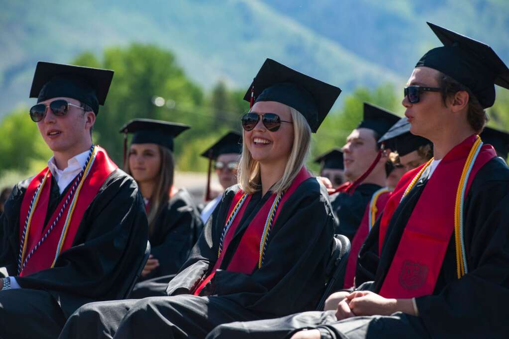 Aspen High School graduates listen to the speeches during the commencement ceremony on the turf field on Saturday, June 5, 2021. (Kelsey Brunner/The Aspen Times)