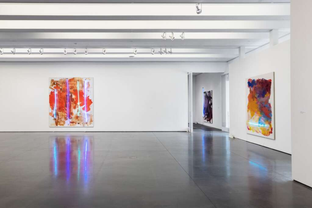 "Installation view of Mary Weatherford, ""Neon Paintings,"" 2020. Credit: Carter Seddon"