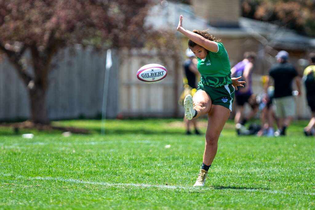 Maleena Mero kicks a conversion attempt during Summit High School's state championship win over Monarch at Cook Park in Denver on Saturday, May 1. | Photo by Liz Copan / Studio Copan
