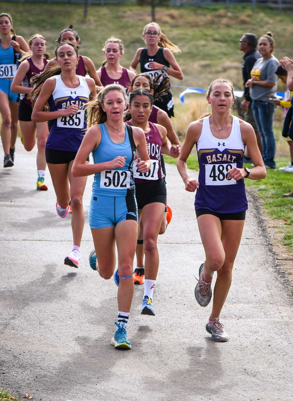 Runners from Coal Ridge, Basalt and Alamosa lead the pack early in the race during Friday's Colorado 3A Region 1 XC meet at VIX Park in New Castle.  Chelsea Self/Post Independent