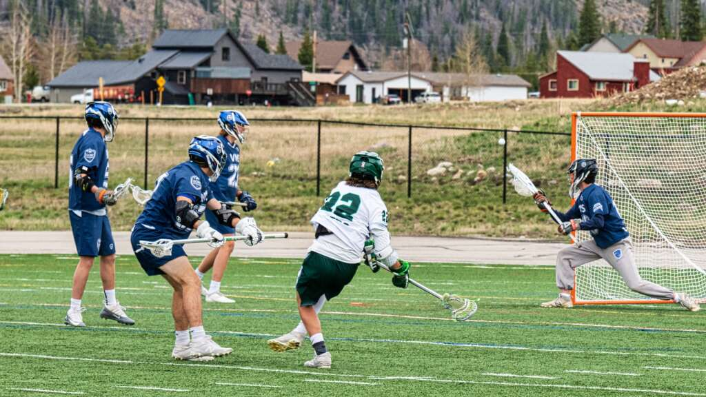 Summit High School's Isaac Dalyrymple (center) shoots on Vail Mountain School's net during the Tigers' 18-4 loss to the Gore Rangers at Tiger Stadium in Breckenridge on Tuesday. | Photo by Joel Wexler / Rocky Mountain.Photography