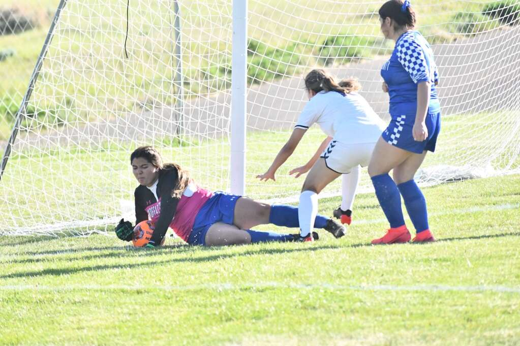 Haley Mendoza, left, makes a save during Moffat County girls soccer's home finale Thursday in Craig. | Andy Bockelman/For the Craig Press