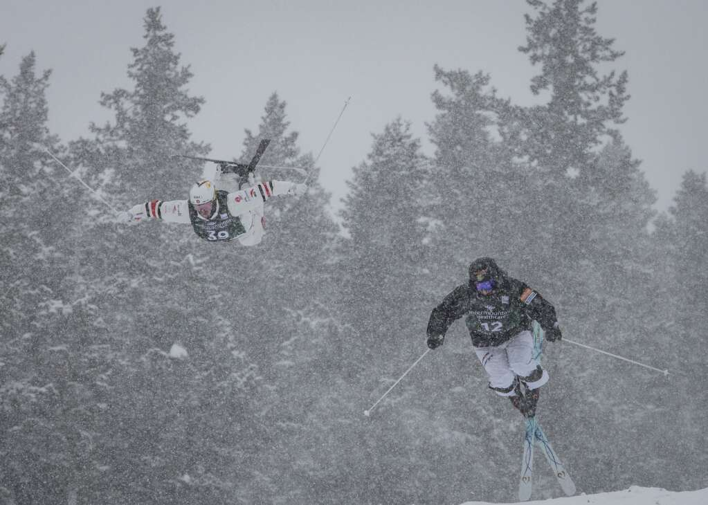 Canada's Mikael Kingsbury (39) and Sweeden's Oskar Elofsson (12) jump off the bottom air together during the dual moguls quarter-finals. (Tanzi Propst/Park Record)